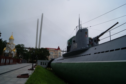 Orthodox church, the Golden Horn Bay bridge and the warhero, the S-56 submarine.